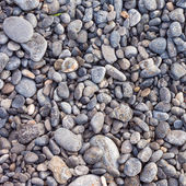 Pebble stones as a background texture — Foto Stock