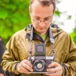 Portrait of male photographer with retro camera — Stock Photo #42350997