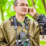 Portrait of male photographer with retro camera — Stock Photo #42351121