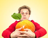 Portrait of funny man with great apple — Stock Photo