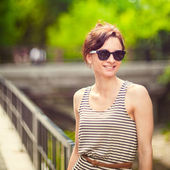 Fashion portrait of a young sexy woman wearing sunglasses with beauty bokeh — Stock Photo