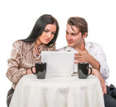 Girl with a guy in a cafe talking and used tablet computer isolated on white — Stock Photo