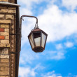 Old lantern against the blue sky — Stock Photo