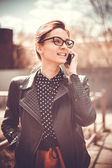 Stylized instagram colorized vintage fashion portrait of a young sexy woman wearing glasses with beauty bokeh and small depth of field — Foto Stock