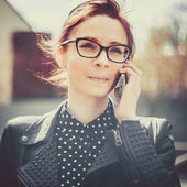 Stylized instagram colorized vintage fashion portrait of a young sexy woman wearing glasses with beauty bokeh and small depth of field — Stock Photo