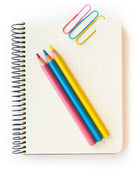 Office and school accessories. Pencil and notebook isolated on white background. — Stockfoto