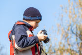 Young child holding and viewing photos on the digital camera — Stock Photo