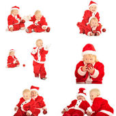Two fanny kids in santa clauss costumes isolated on white — Stock Photo