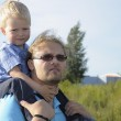 Father and son walking — Stock Photo #12875005