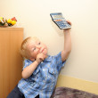 Cute boy in office with calculator — Stock Photo #12875819