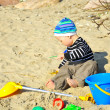 Cute boy playing on a beach — Stock Photo #13178995