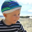 Cute boy playing on a beach — Stock Photo #13179058