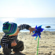 Cute boy playing on a beach — Stock Photo #13179118