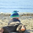 Cute boy playing on a beach — Stock Photo #13179231