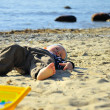 Cute boy playing on a beach — Stock Photo #13179418