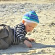 Cute boy playing on a beach — Stock Photo #13179607