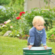 Little baby boy gardener playing  — Stock Photo