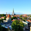 Royalty-Free Stock Photo: Red roofs and church of old Tallinn