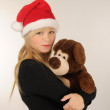 Santa woman with bear — Stock Photo #14877643