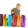 Cute boy with shopping bags after shopping. isolated on white — Stock Photo
