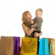 Beautiful woman and her son after shopping. isolated on white — Stock Photo