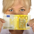 Young woman holding euro money on a white background — Stok fotoğraf