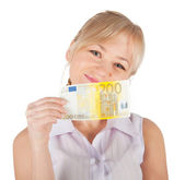 Young woman holding euro money on a white background — Stock Photo