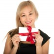 Beautiful blonde woman and gift postcard in her hands. feast day of St. Valentine — Stock Photo #18510867