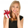 Beautiful blonde woman and gift postcard in her hands. feast day of St. Valentine — Stock Photo