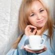 Alluring sexy woman in man boyfriend shirt at home with coffee at morning. — Stock Photo