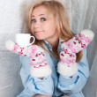 Woman in man shirt with warm wool socks with hearts — Stock Photo