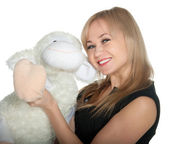 Happy woman with toy sheep over white — Stock Photo