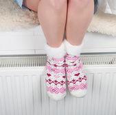Woman legs in woolen socks with hearts — Stock Photo