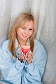 Woman in man shirt with candle in hands — Stockfoto