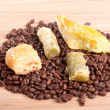 Baklava cakes and coffee beans on a wooden table - Stock Photo