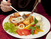 Grilled chicken steak, baked potatoes and vegetables with knife an fork — Stock Photo