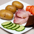 Grilled pork with boled potato, vegetables and bread — Stok Fotoğraf #21180127