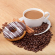 Coffee cup with coffee beans ans sweet cake on a wooden background — Stock Photo #21719223