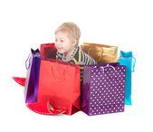 Alışveriş torbaları ile çekici çocuk — Stok fotoğraf