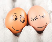 Two funny smiling eggs in a packet — ストック写真