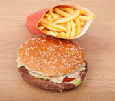 Breakfast set: hamburger and french fries on wooden background. — Stock Photo