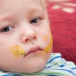 Painted boy face — Stock Photo #21918897
