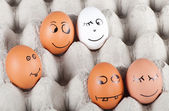 Group of funny smiling eggs in a packet — Stock Photo