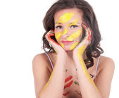 Happy young woman painting herself — Stock Photo