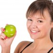 Beautiful young sport  woman with green apple, isolated on white — Stock Photo #23595243