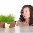 Beautiful woman with easter basket with green grass, chicken and smiling egg — Стоковая фотография