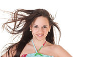 Attractive woman in summer dress and her hair on a wind — Stock Photo