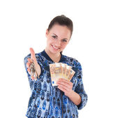 Woman with keys and money. — Stock Photo