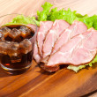 Ham and lettuce with glass of a cola  on a wooden plate — Stock Photo