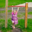 Little girl playing outdoor — Stock Photo